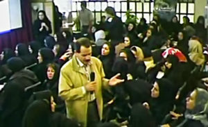 Institute of Interuniversal Mysticism in Gandhi Street, Tehran, Iran. The photo is captured from his video while he is teaching among students.